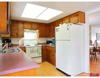 """Photo 2: 19719 50A Ave in Langley: Langley City House for sale in """"Eagle Heights"""" : MLS®# F2708352"""