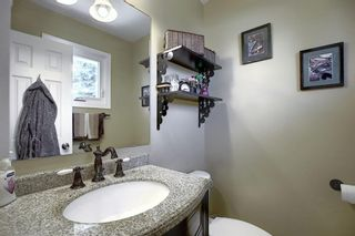 Photo 18: 408 QUEENSLAND Circle SE in Calgary: Queensland Detached for sale : MLS®# A1020270