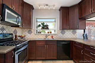 Photo 1: TALMADGE House for sale : 4 bedrooms : 4660 HINSON PLACE in San Diego