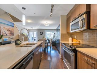 """Photo 2: 220 2110 ROWLAND Street in Port Coquitlam: Central Pt Coquitlam Townhouse for sale in """"AVIVA ON THE PARK"""" : MLS®# R2598714"""