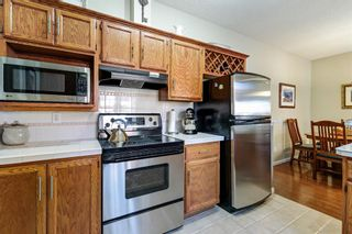 Photo 6: 101 1997 Sirocco Drive SW in Calgary: Signal Hill Row/Townhouse for sale : MLS®# A1142333