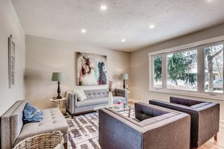 Photo 2: 7412 FARRELL Road SE in Calgary: Fairview Detached for sale : MLS®# A1062617