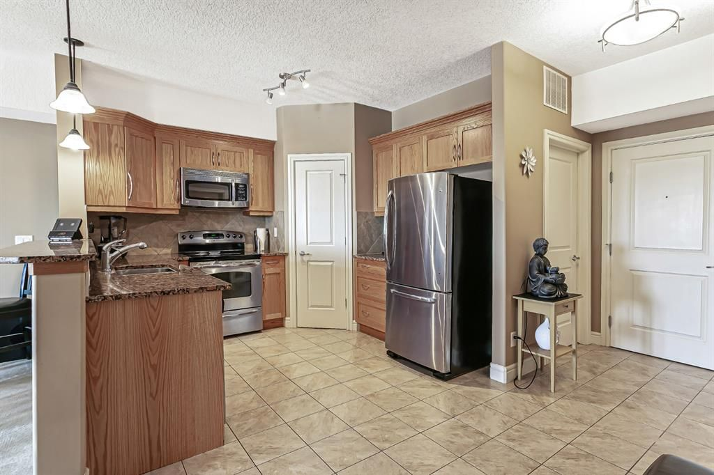 Photo 7: Photos: 1445 2330 FISH CREEK Boulevard SW in Calgary: Evergreen Apartment for sale : MLS®# A1082704
