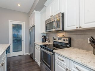 Photo 7: 600 Evanston Link NW in Calgary: Evanston Semi Detached for sale : MLS®# A1026029