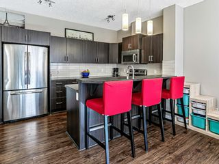 Photo 8: 1020 10 Auburn Bay Avenue SE in Calgary: Auburn Bay Row/Townhouse for sale : MLS®# A1095152