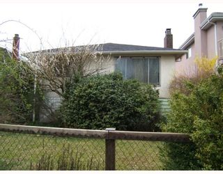Photo 10: 5505 KILLARNEY Street in Vancouver: Collingwood VE House for sale (Vancouver East)  : MLS®# V811445