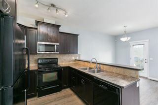 Photo 6: 58 Arbours Circle NW: Langdon Row/Townhouse for sale : MLS®# A1137898
