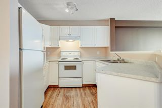 Photo 8: 1306 604 8 Street SW: Airdrie Apartment for sale : MLS®# A1066668