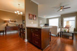 """Photo 6: 408 20286 53A Avenue in Langley: Langley City Condo for sale in """"CASA VERONA"""" : MLS®# R2177236"""