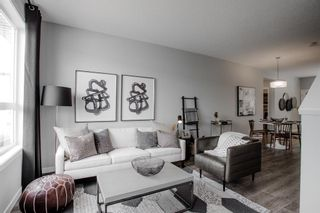 Photo 8: 606 16 Evanscrest Park NW in Calgary: Evanston Row/Townhouse for sale : MLS®# A1088021