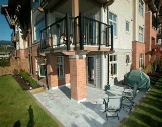 """Photo 1: 500 KLAHANIE Drive in Port Moody: Port Moody Centre Condo for sale in """"THE TIDES"""" : MLS®# V635966"""