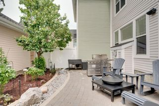 Photo 2: 212 Somme Avenue SW in Calgary: Garrison Woods Row/Townhouse for sale : MLS®# A1129738