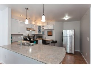 "Photo 9: 401 11605 227 Street in Maple Ridge: East Central Condo for sale in ""HILLCREST"" : MLS®# R2256428"