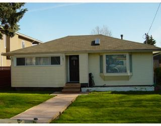 Photo 1: 7208 STRIDE Avenue in Burnaby: Edmonds BE House for sale (Burnaby East)  : MLS®# V812878