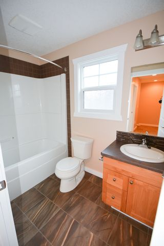 Photo 10: 8720 76 Street in Fort St. John: 1/2 Duplex for sale