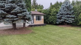 Photo 1: 63014 PR 307 Highway: Seven Sisters Falls Residential for sale (R18)  : MLS®# 202120994