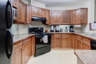 Photo 21: 111 72 Quigley Drive: Cochrane Apartment for sale : MLS®# A1137797