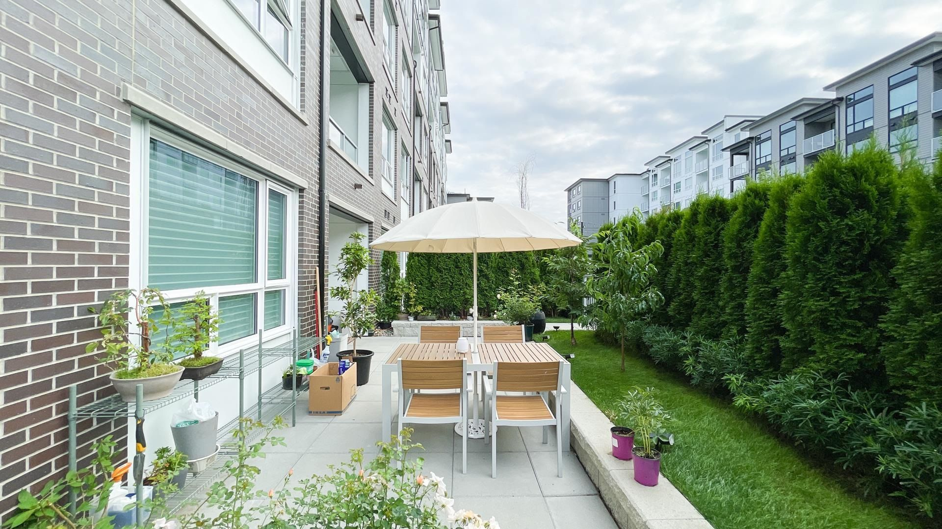 Main Photo: 108 9233 ODLIN Road in Richmond: West Cambie Condo for sale : MLS®# R2596265