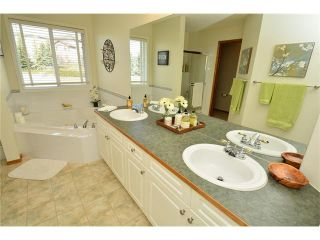 Photo 25: 108 GLENEAGLES Terrace: Cochrane House for sale : MLS®# C4113548