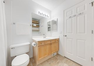 Photo 24: 218 950 ARBOUR LAKE Road NW in Calgary: Arbour Lake Row/Townhouse for sale : MLS®# A1136377