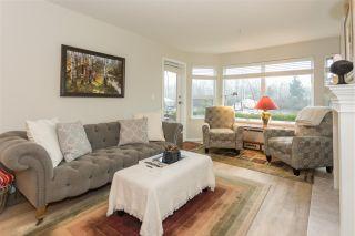 """Photo 2: 103 1468 PEMBERTON Avenue in Squamish: Downtown SQ Condo for sale in """"MARINA ESTATES"""" : MLS®# R2237137"""