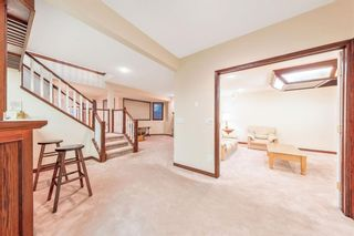 Photo 32: 217 Signature Way SW in Calgary: Signal Hill Detached for sale : MLS®# A1148692