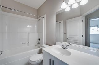 Photo 15: 29 Somme Boulevard SW in Calgary: Garrison Woods Row/Townhouse for sale : MLS®# A1129180