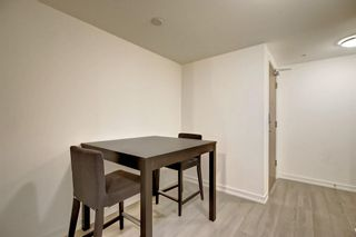 Photo 9: 114 51 WATERFRONT Mews SW in Calgary: Chinatown Apartment for sale : MLS®# C4301606