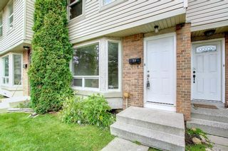 Photo 3: 77 123 Queensland Drive SE in Calgary: Queensland Row/Townhouse for sale : MLS®# A1145434