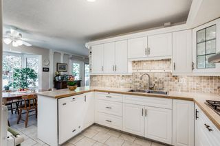 Photo 13: 531 Ranch Estates Place NW in Calgary: Ranchlands Detached for sale : MLS®# A1129304