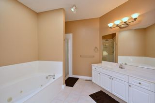 Photo 32: 303 GLENEAGLES View: Cochrane House for sale : MLS®# C4130061
