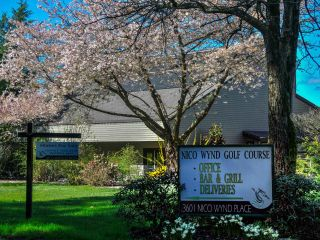"""Photo 1: 12 14065 NICO WYND Place in Surrey: Elgin Chantrell Condo for sale in """"NICO WYND ESTATES & GOLF"""" (South Surrey White Rock)  : MLS®# R2607787"""
