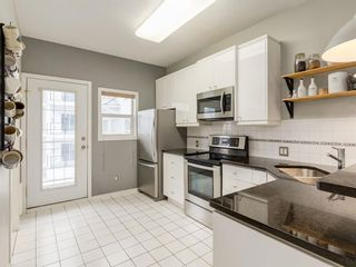 Photo 3: 15 1441 23 Avenue SW in Calgary: Bankview Row/Townhouse for sale : MLS®# A1065382
