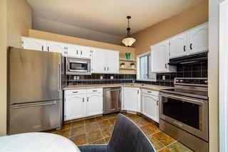 Photo 5: 4 WEST MCDOUGAL Road: Cochrane House for sale : MLS®# C4194007