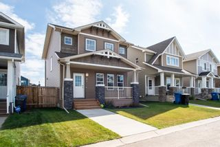 Photo 1: 64 Mackenzie Way: Carstairs Detached for sale : MLS®# A1036489