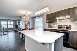 Photo 16: 1319 Panatella Boulevard NW in Calgary: Panorama Hills Semi Detached for sale : MLS®# A1145532