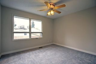 Photo 15: 77 123 Queensland Drive SE in Calgary: Queensland Row/Townhouse for sale : MLS®# A1145434