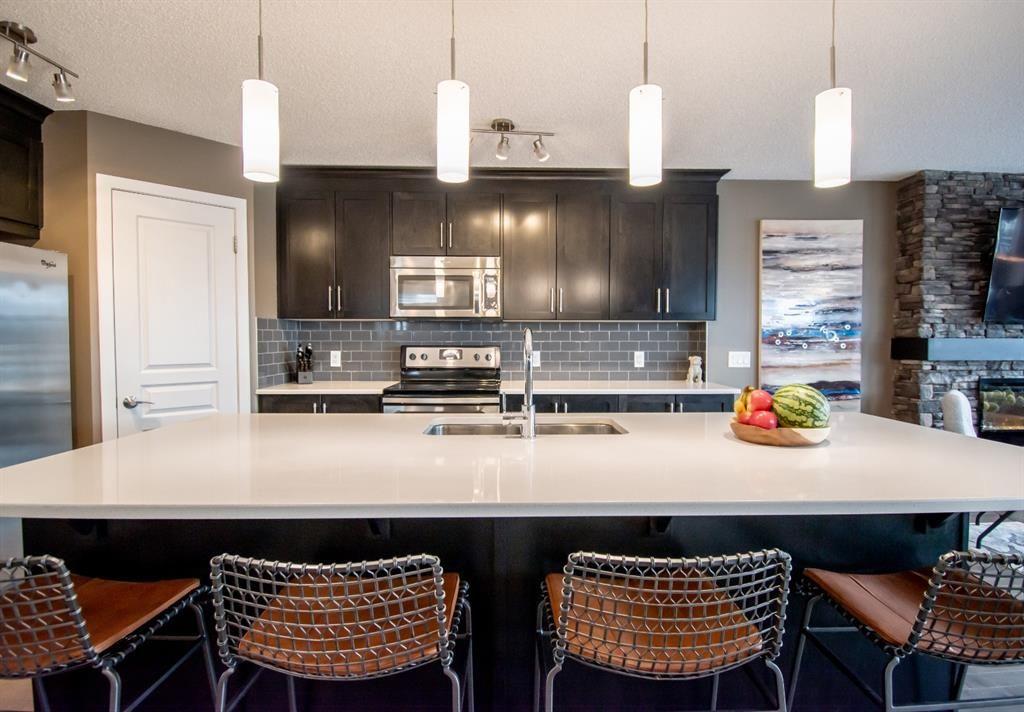 Photo 4: Photos: 281 AUBURN MEADOWS Place SE in Calgary: Auburn Bay Duplex for sale : MLS®# A1014528