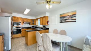 Photo 9: 879 W 60TH Avenue in Vancouver: Marpole House for sale (Vancouver West)  : MLS®# R2606107