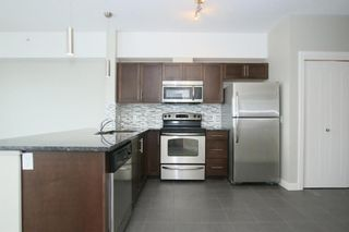 Photo 2: 2414 604 EAST LAKE Boulevard NE: Airdrie Apartment for sale : MLS®# A1016505