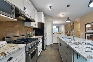 Photo 18: 175 Ypres Green SW in Calgary: Garrison Woods Row/Townhouse for sale : MLS®# A1103647