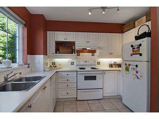 """Photo 2: 84 1561 BOOTH Avenue in Coquitlam: Maillardville Townhouse for sale in """"THE COURCELLES"""" : MLS®# V1087510"""