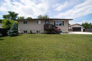 Photo 1: 703 4th Street NE in Portage la Prairie: House for sale : MLS®# 202115922