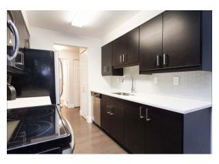 """Photo 4: 102 2299 E 30TH Avenue in Vancouver: Collingwood VE Condo for sale in """"TWIN COURT"""" (Vancouver East)  : MLS®# V1010933"""