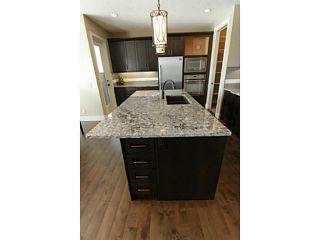 Photo 9: 29 CIMARRON ESTATES Link: Okotoks Residential Detached Single Family for sale : MLS®# C3594396