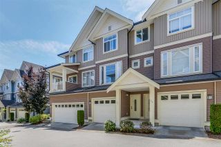 "Photo 1: 69 6575 192 Street in Surrey: Clayton Townhouse for sale in ""Ixia"" (Cloverdale)  : MLS®# R2076740"
