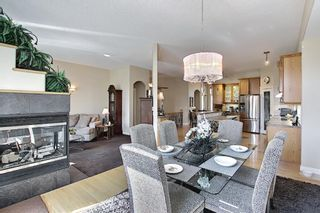 Photo 15: 31 Strathlea Common SW in Calgary: Strathcona Park Detached for sale : MLS®# A1147556
