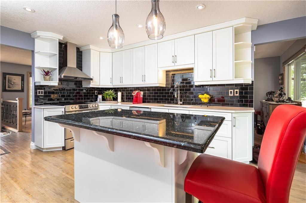 Main Photo: 4 GLENHILL Drive: Cochrane Detached for sale : MLS®# C4301676