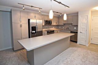 Photo 2: 1307 10 Market Boulevard SE: Airdrie Apartment for sale : MLS®# A1054486