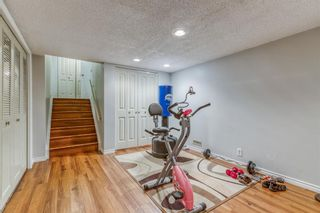 Photo 25: 10 Coach  Manor Rise SW in Calgary: Coach Hill Row/Townhouse for sale : MLS®# A1077472